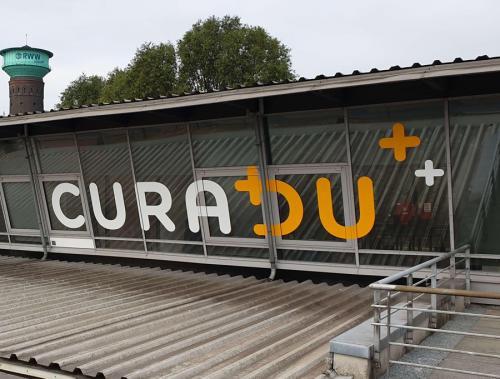 Fassadenbeschriftung Curadu Werbekopf Reken